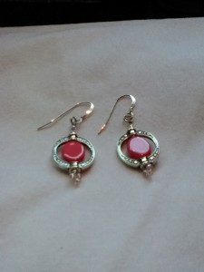 Earrings, silver w/antique oval and salmon colored stone. $15.00